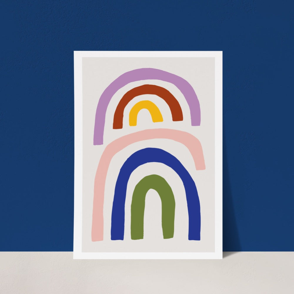 A colourful Giclée Art Print featuring a smaller rainbow embracing a larger rainbow. A cheerful addition to any space.