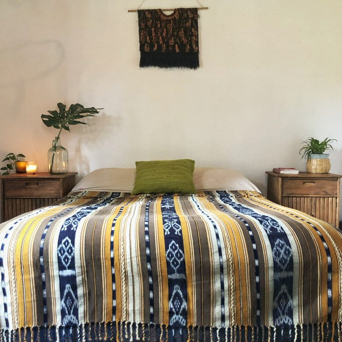 Cotton ikat bedspread in tan