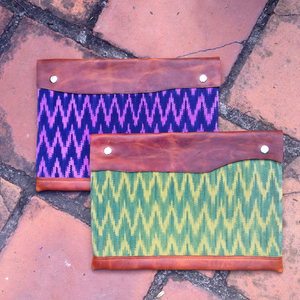Naturally-dyed and handwoven textile laptop sleeve with leather