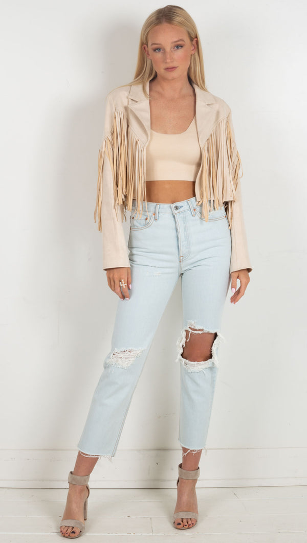light wash crop jeans with big hole on left leg blue