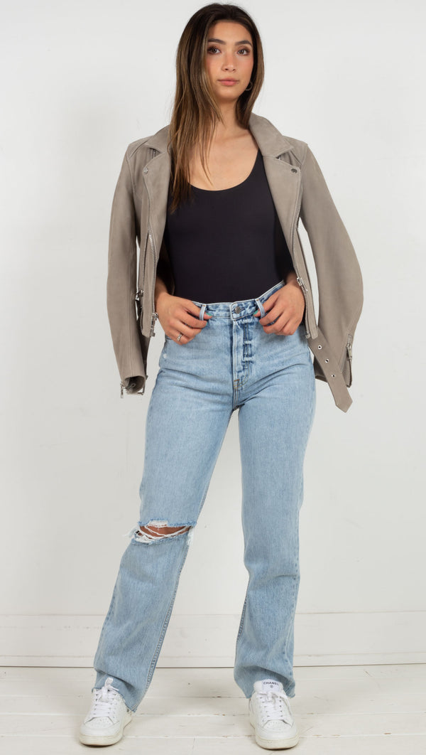 high waisted long jeans with one rip on the right leg light blue