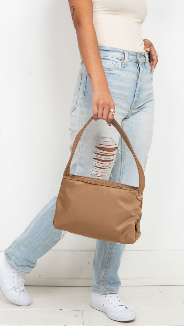 recycled material medium sized bag one strap brown