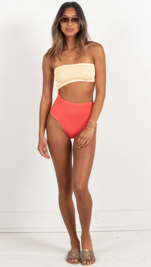 strapless one piece with ring detail on side pink and cream