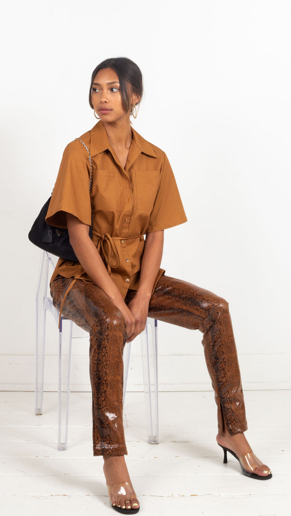 snake print leather pant tight with slits by the ankles orange and black