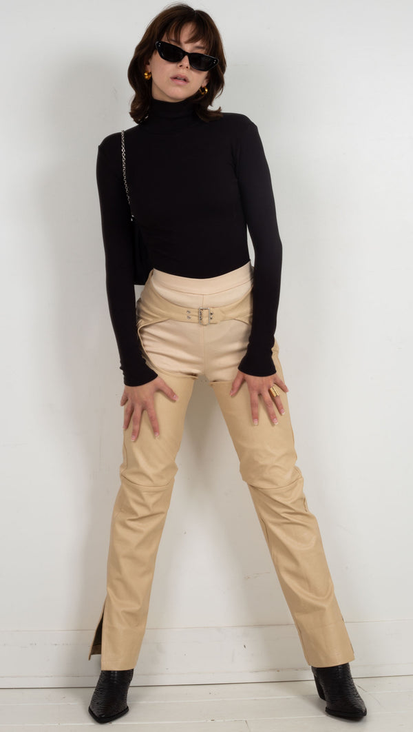 leather chaps with pants under nude