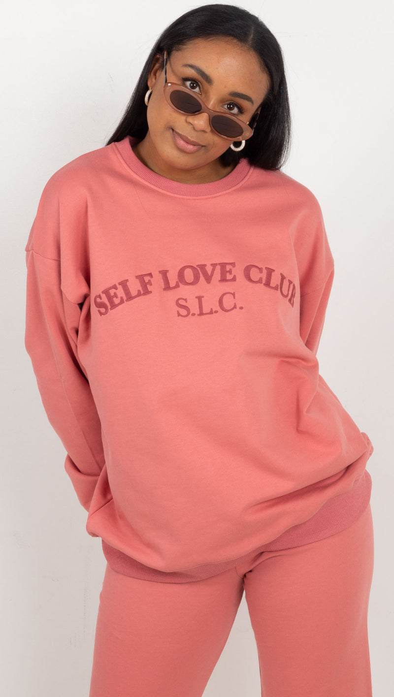 embroidered 'self love club' on chest sweat shirt pink