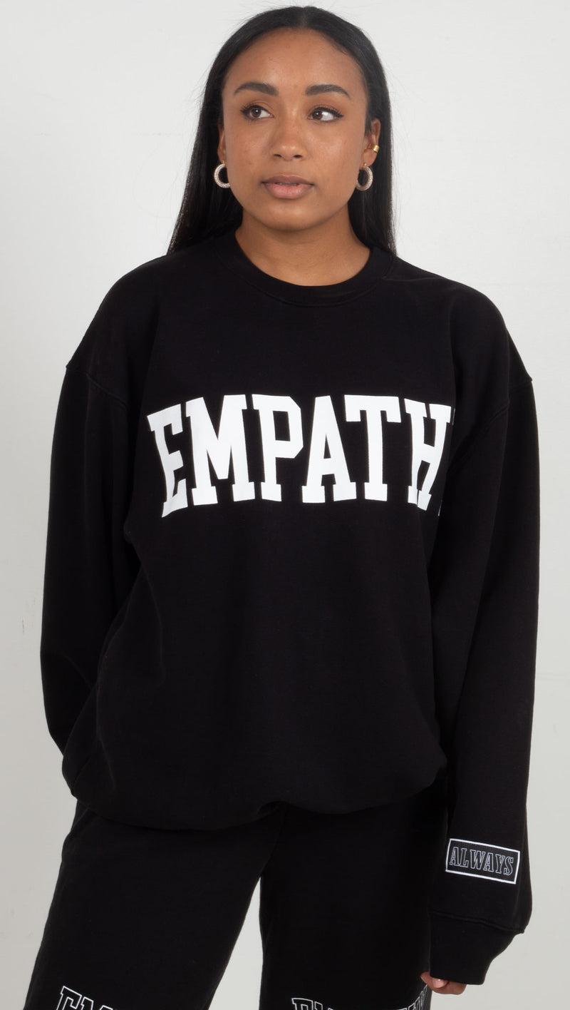 black sweatshirt with empathy on the chest