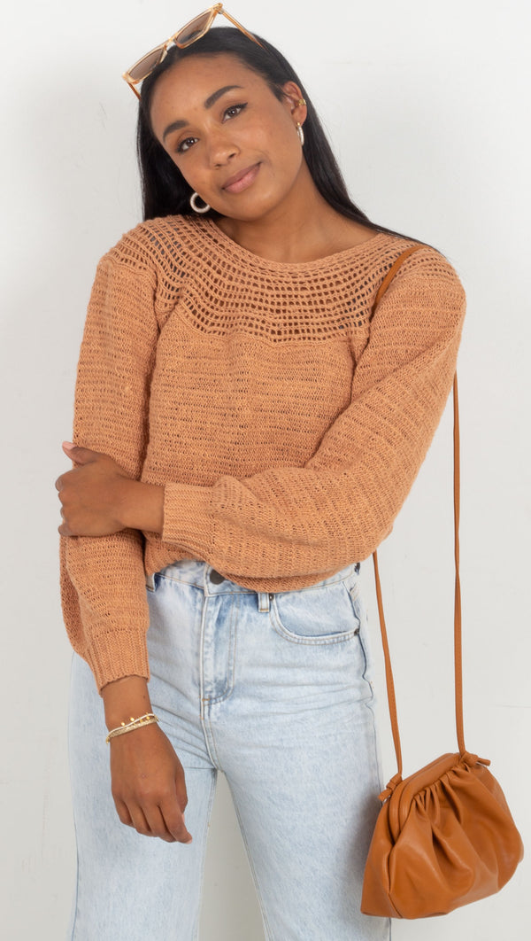 knit sweater with more spaced out knit at the neck line burnt orange