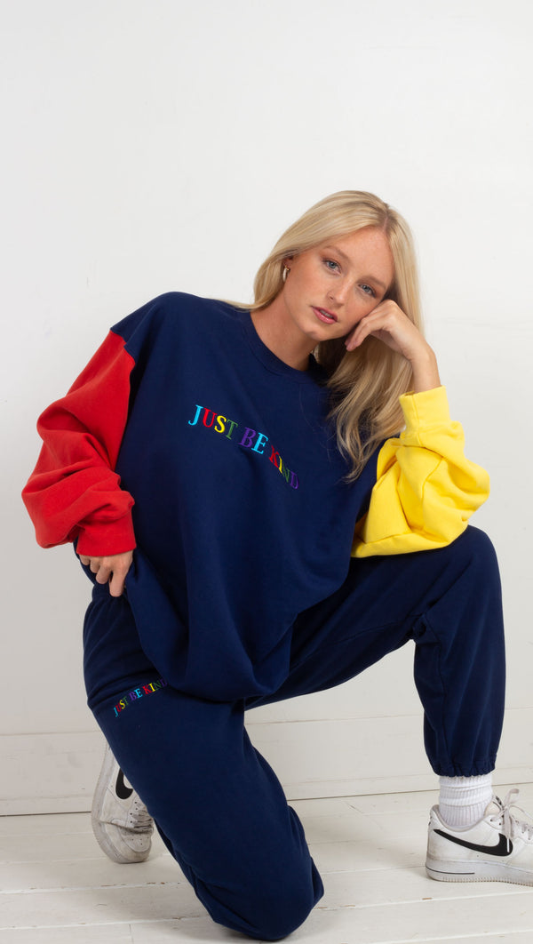 just be kind colorblock sweat shirt one red and one yellow sleeve