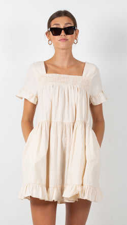 beige smocked mini dress with ruffle detail