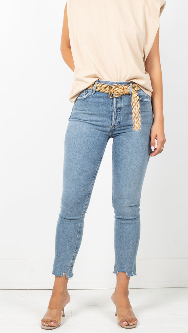 Agolde Medium Wash High Rise Skinny Jean with Distressed Hem