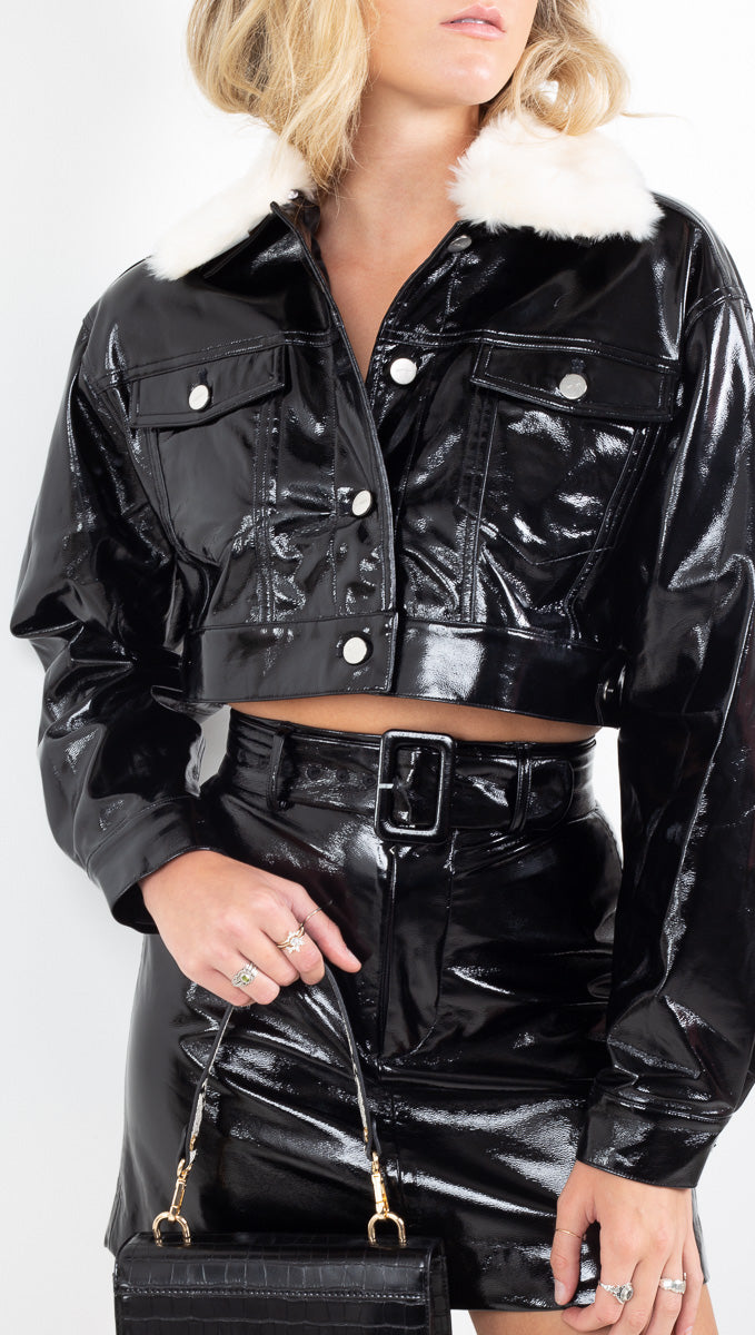 Capulet black patent vegan leather cropped jacket with cream faux fur collar