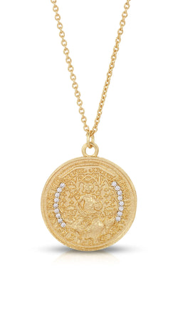 gold necklace with coin looking pendant