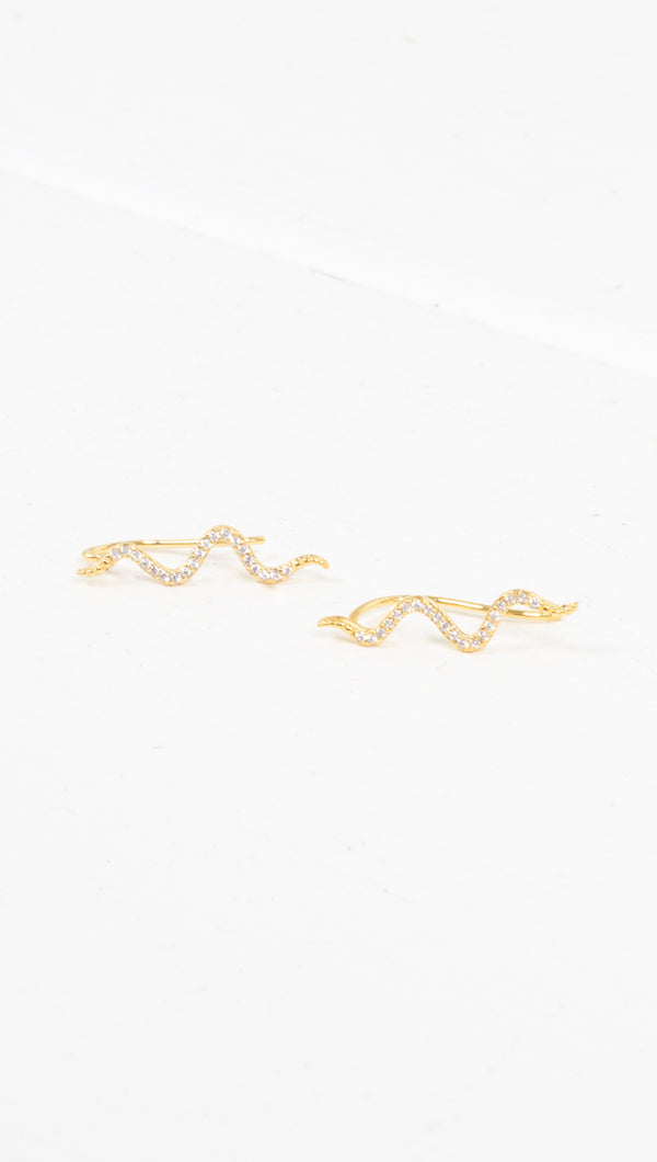 étoile gold thin snake crawler earrings with clear crystal studs