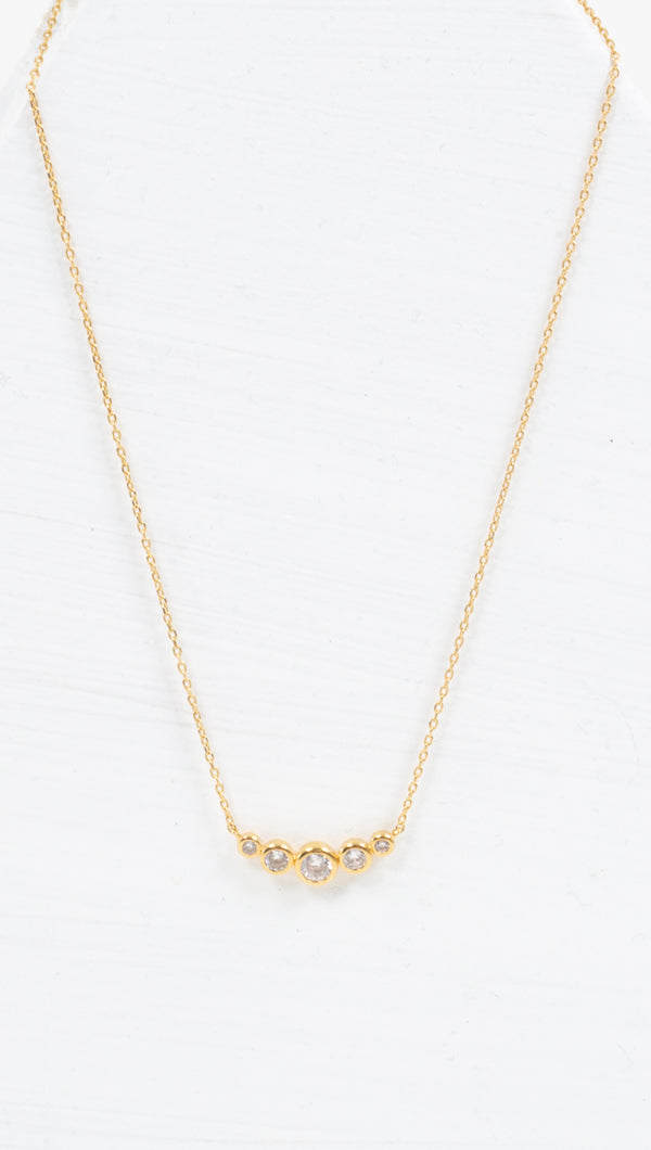 étoile thin gold necklace with 5 gold/crystal studs lined in center