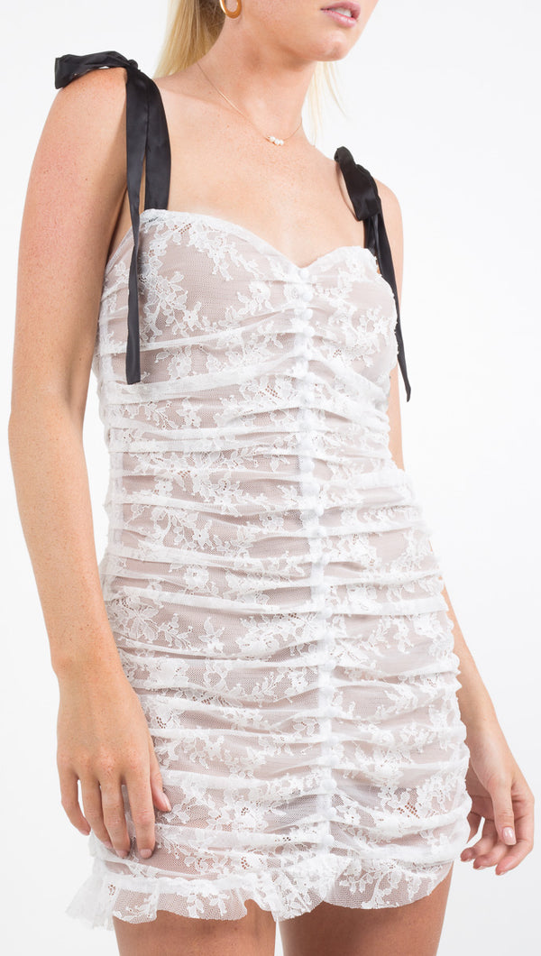 For Love and Lemons white lace mini dress with black ribbon tie straps