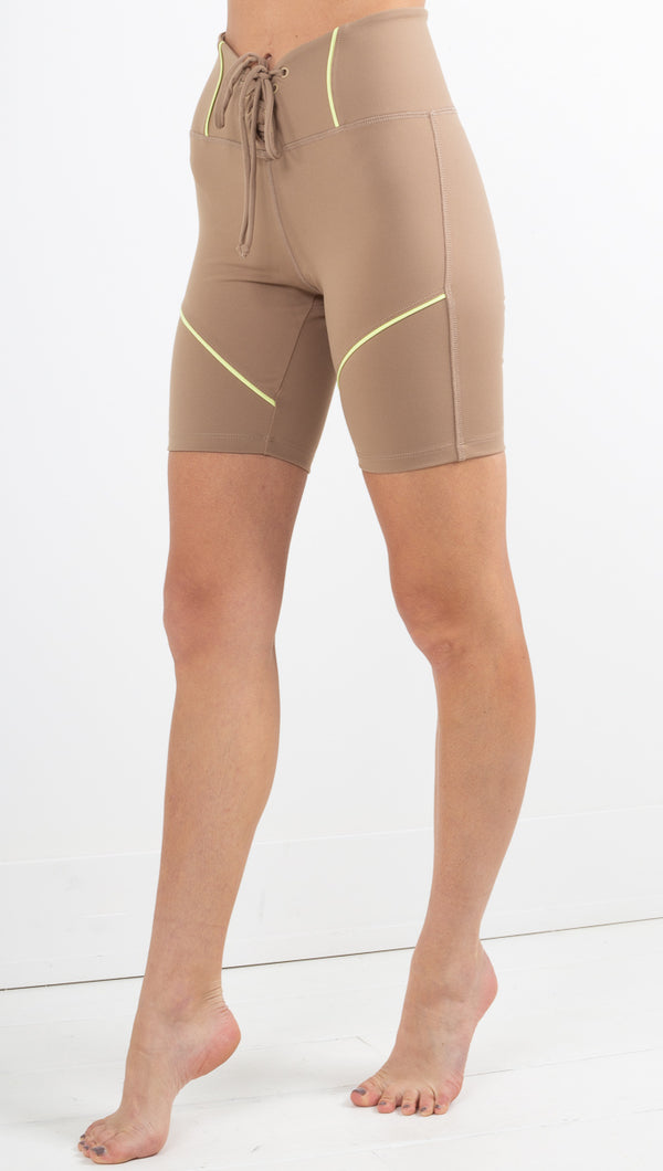 Year Of Ours tan biker shorts with lace up front and lime green detail