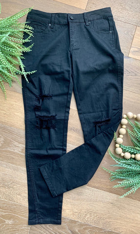 Distressed black denim jeans