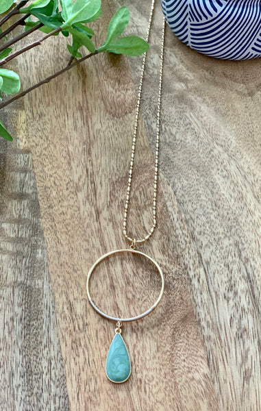 Round gold necklace with tear drop