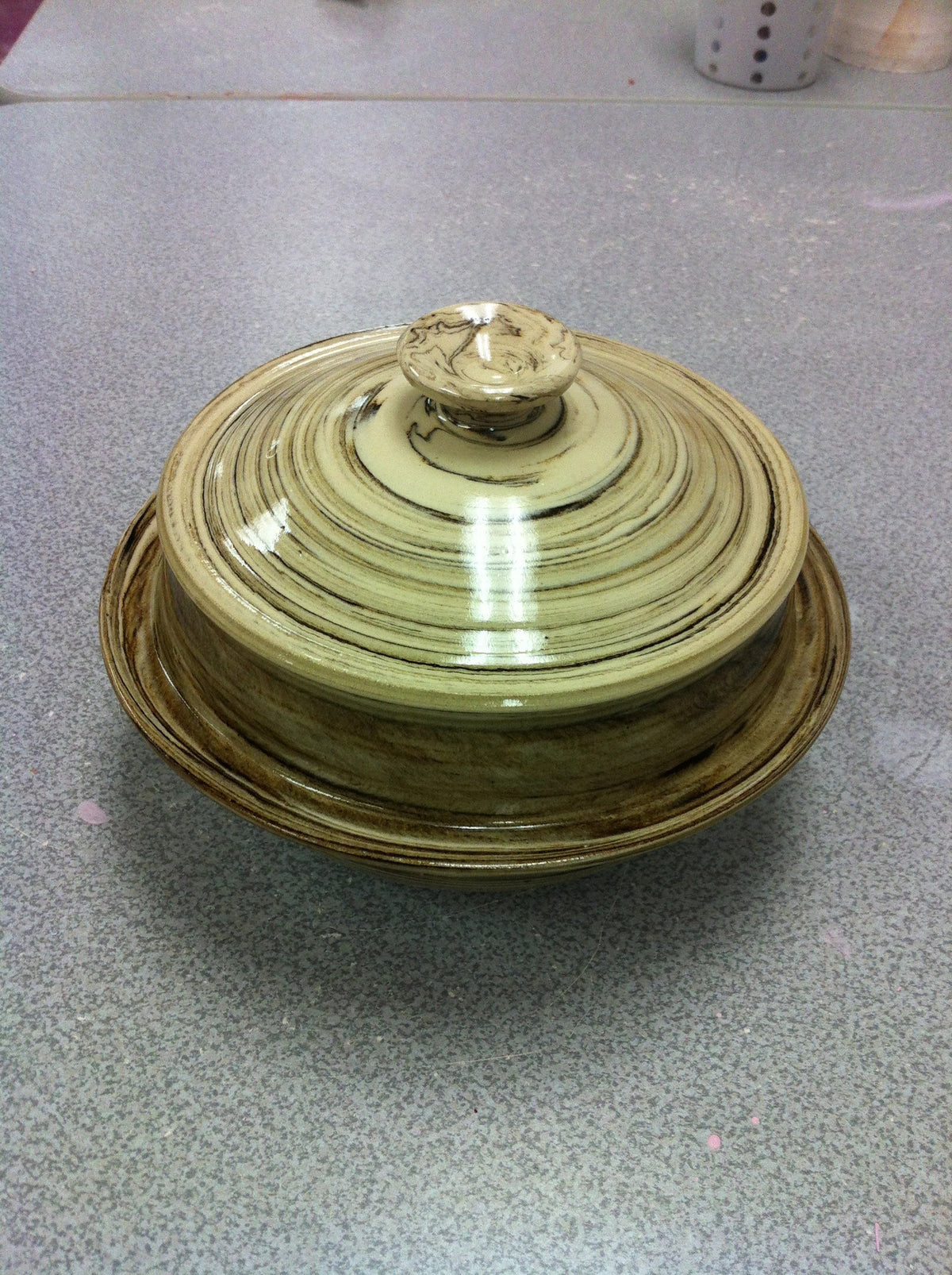 Lidded jar with marbling effect.