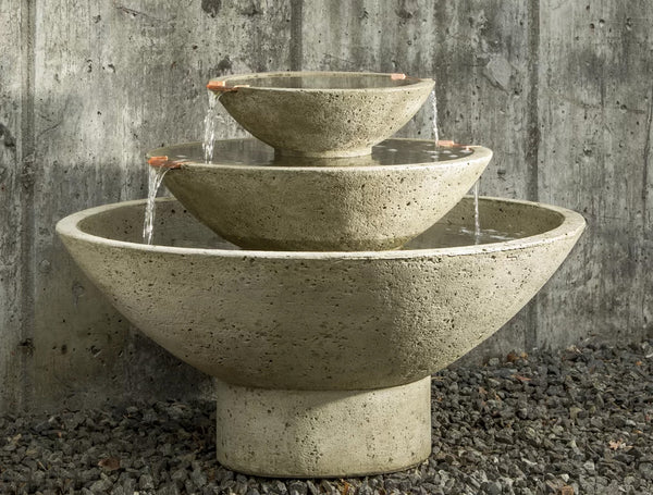 An image of the Three-Tiered Carrera modern fountain from Creative Living in a natural stone color.