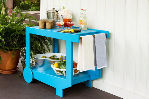 An image of the fully stocked Lollygagger Bar Cart from Creative Living.