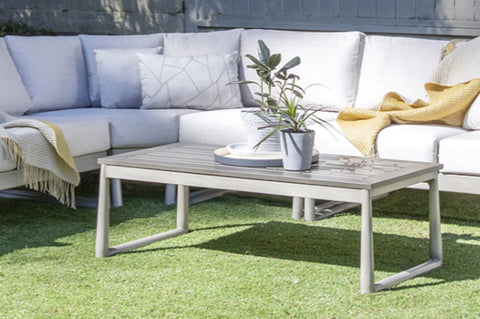 An image of two plants on top of the Park West Coffee Table from Creative Living's collection of outdoor furniture.