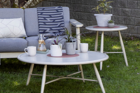 An image of the Polanco Round End Table from Creative Living's collection of outdoor furniture with plants and coffee on top.