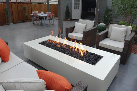 An image of the lit Rectangular CL Steel modern fire pit from Creative Living in white.