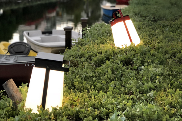 An image of two Bump solar lanterns from Creative Living sitting in a bush.