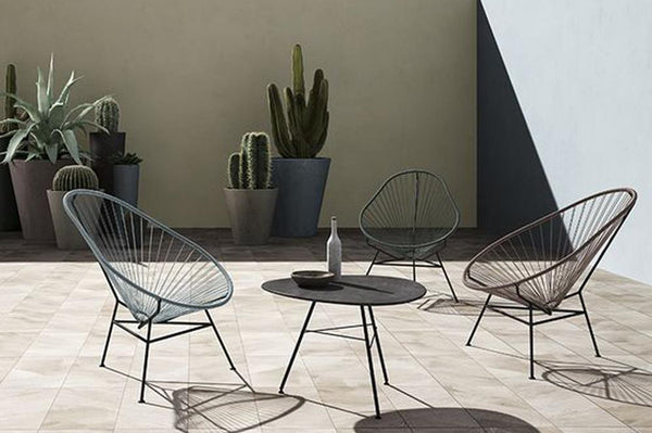 An image of two chair from Creative Living's collection of modern patio furniture.