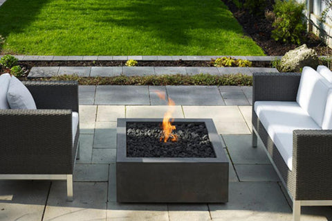 An image of Creative Living's Bento modern fire pit on an outdoor patio.