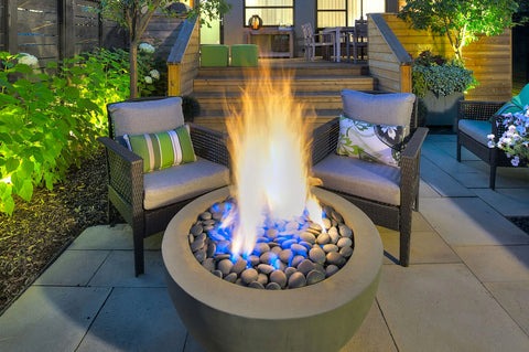An image of a blazing fire in the Fire Bowl modern fire pit from Creative Living.