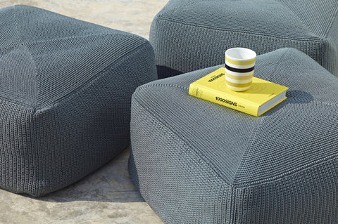 An image of a yellow book and coffee cup on the Divine Outdoor Footstool from Creative Living.