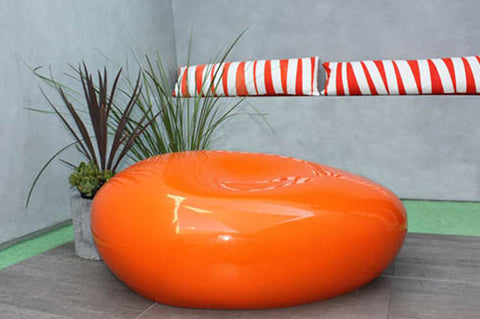 An image showing a bright orange Outdoor Seating Pebble from Creative Living.