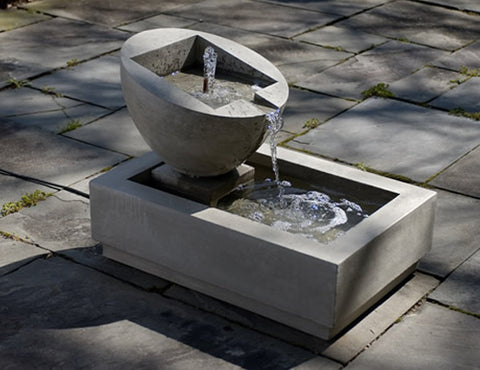 An image of the Genesis II modern fountain from Creative Living on an outdoor stone floor.