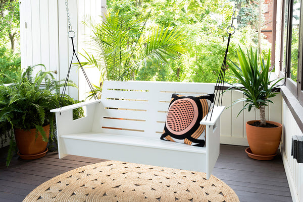 An image featuring the white Go Porch Swing from Creative Living.
