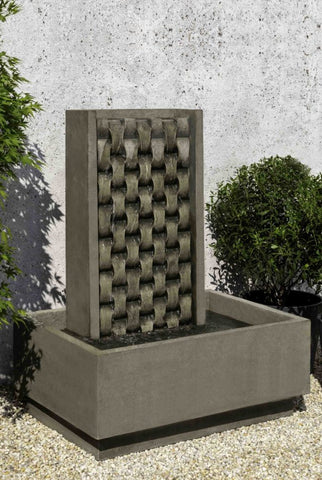 An image of the M Weave modern fountain with a weaved pattern from Creative Living.