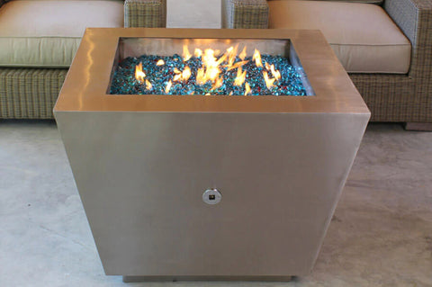 An image of the lit Stainless Steel Pyramid modern fire pit from Creative Living.