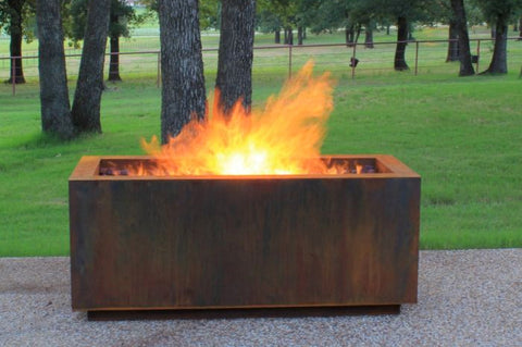 An image of the lit Rectangular Steel modern fire pit from Creative Living.