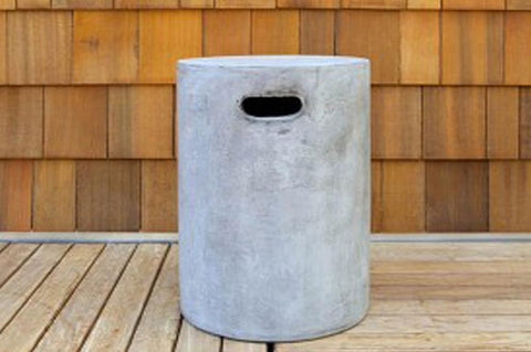 An image of the Round Urban Concrete Stool from Creative Living's collection of outdoor furniture against a background of wood siding.