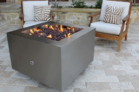 An image of the lit Stainless Steel Square modern fire pit from Creative Living.