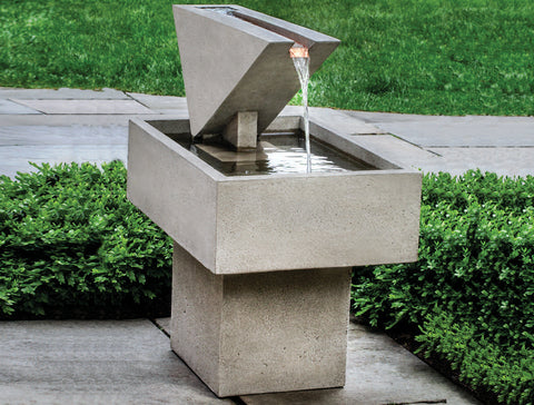An image of the Outdoor Triad modern fountain from Creative Living against a background of green grass.