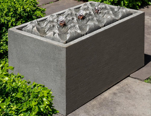 An image of the Waves modern fountain in grey from Creative Living.