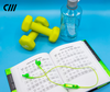 Candywires Neon Wireless earbuds pictured with weights. Ready to workout with these headphones