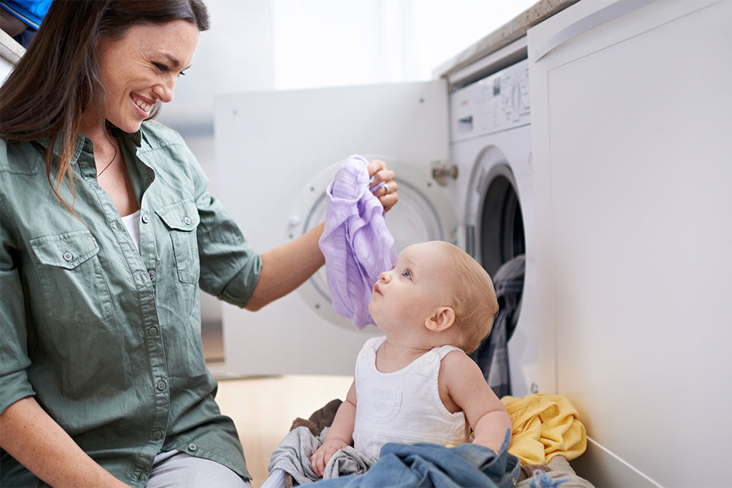 mum and child doing laundry
