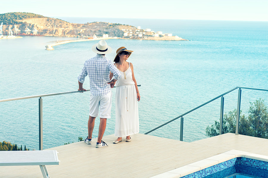 couple admire beach from the pool