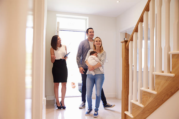 couple-with-baby-new-home