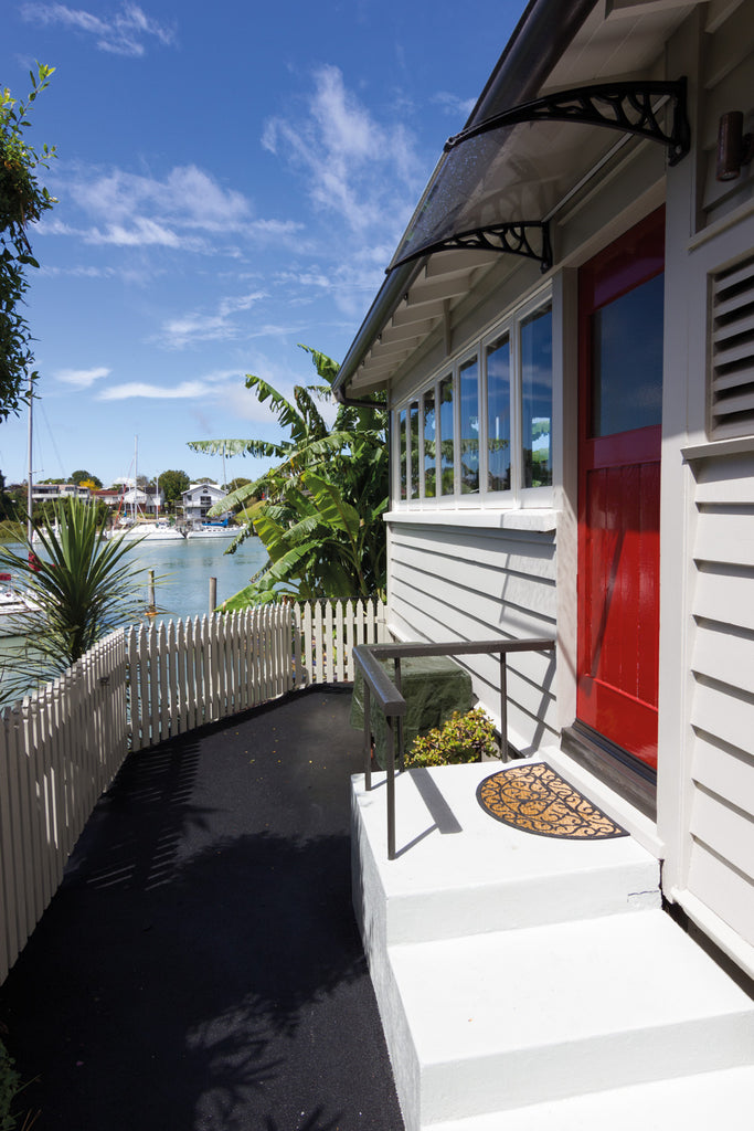 The third small dwelling overlooks the Tamaki River