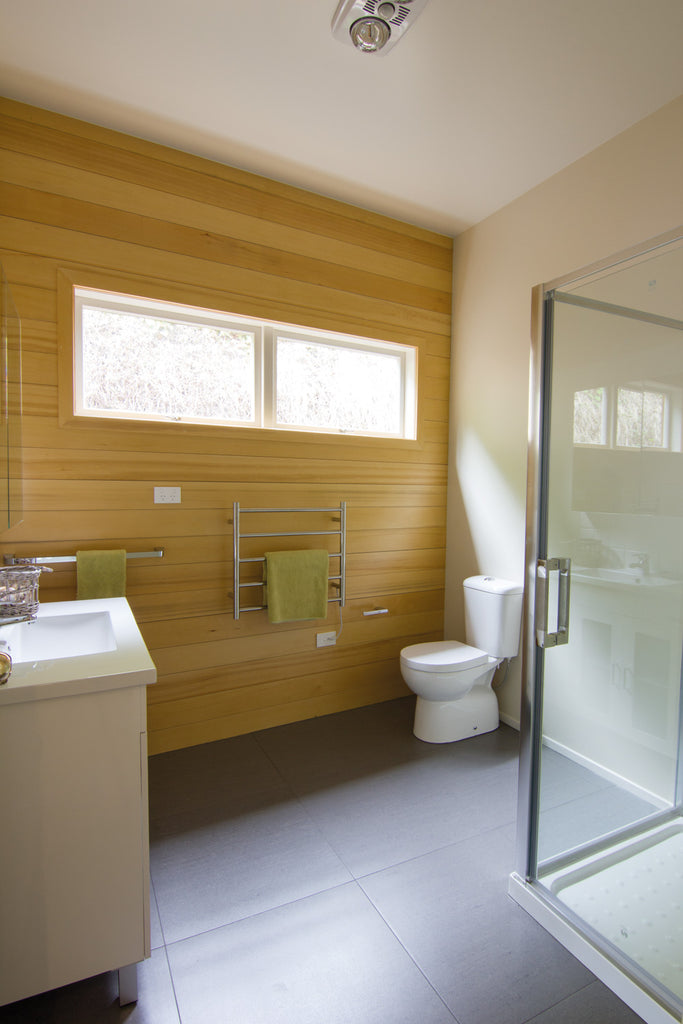 Walls are lined with oiled yellow cedar in each bathroom